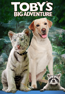"alt=""After accidentally becoming separated from his human caretakers, Toby, a baby white tiger, is joined begrudgingly by Lana, a crotchety old dog, to embark on a journey through the wilderness. In order to find their way home, they will need the help of woodland creatures to escape a pack of hungry coyotes, and other lurking dangers. CAST AND CREDITS Actors Georgina Kidder, Toni Tinkleman, Richard Valentin Jr., Austen Moret Director Michael Sarna"""